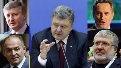 Политики и олигархи работают рука об руку, чтобы грабить Украину