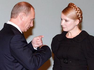 Владимир Путин объясняет Юлии Тимошенко, что Украина теперь будет сама выпутываться из сложного положения, в которое себя загнала. Фото EPA.